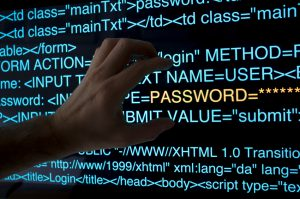 In the dark, a hacker tries to steal a password from a HTML logon script